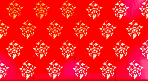 Golden Thai pattern on red Stock Photo