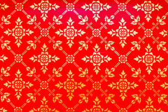 Golden Thai pattern on red Stock Photo