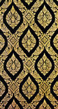 Golden Thai pattern on wall Royalty Free Stock Images