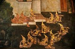 Golden Thai Ramayana drawing on a wall in Bangkok  Stock Photos