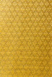Golden thai silk cloth pattern background Stock Photos