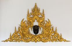 Golden Thai style stucco. Gold stucco Thai style on a white background Stock Photography