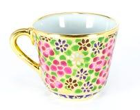 The golden thai tea cup Stock Photos