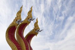 Golden three headed naga statue Stock Images