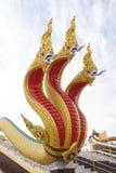 Golden three headed naga statue Royalty Free Stock Photos