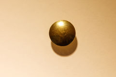 Golden Thumb Tack head. Thumb Tack / Push Pin head close up royalty free stock photo