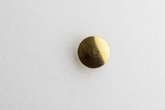 Golden Thumb Tack head. Thumb Tack / Push Pin head with a white background stock photography