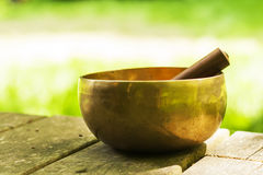 Golden tibetan bowl Stock Photos