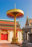 Golden tiered umbrella in temple Stock Photos