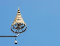 Golden tiered umbrella Stock Photography