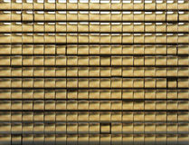 Golden tiled wall Stock Photo