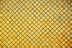 Golden tiles mosaic background. Stock Photo
