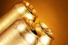 Golden tin cans on yellow Royalty Free Stock Image