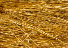 Golden tinsel as background Royalty Free Stock Photos