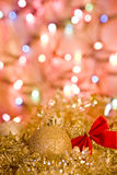 Golden tinsel and ball with lights for Christmas. Card Royalty Free Stock Photography