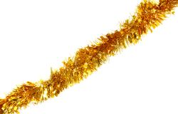 Golden tinsel for Christmas. Isolated on a white background Stock Photo
