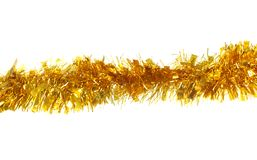 Golden tinsel for Christmas. Isolated on a white background Royalty Free Stock Photography