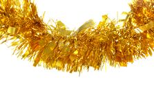 Golden tinsel for Christmas. Isolated on a white background Royalty Free Stock Photos