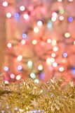 Golden tinsel decoration for Christmas card Royalty Free Stock Images