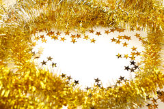 Golden tinsel garland Stock Photo