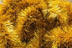 Golden tinsel Royalty Free Stock Photo