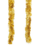 Golden tinsels aginst white background Stock Image
