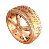 Golden tire on white isolated background. Royalty Free Stock Images