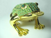 Golden toad. Figurine of toad - a Chinese symbol of richness and prosperity, close up view Royalty Free Stock Photography