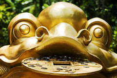 The golden toad sculptures, close-up,. Toad, park carving decoration, very popular with tourists like Royalty Free Stock Images