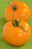 Golden tomatoes. On green napkin in vertical format Royalty Free Stock Photo