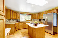 Golden tones kitchen interior with island and skylight Royalty Free Stock Images