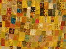 Golden tones in quilt royalty free stock photos