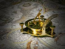Golden Tool on White Brown and Black Map Royalty Free Stock Images