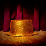Golden top hat on a stage Stock Photo