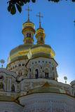 Golden tops of Christian Orthodox Abbey. Vertical Royalty Free Stock Images