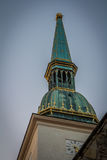 Golden tower. Evening light catching one of the ancient bell towers in Bratislava Stock Photography