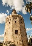 Golden Tower of Seville. Seville's Golden Tower stands against a picture perfect sky Royalty Free Stock Photography