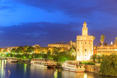 Golden Tower (Torre del Oro) of Seville, Andalusia,. Spain over river Guadalquivir at sunset royalty free stock image