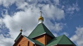 Golden towers of christian wooden church Royalty Free Stock Photography