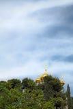 Church of Maria Magdalene Among Trees. The golden towers of the Church of Maria Magdalene are seen among the trees. The church is dedicated to Mary Magdalene ( Royalty Free Stock Image