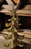 Golden toy in the shape of a Christmas tree Royalty Free Stock Photos
