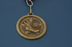 Golden track and field medal Royalty Free Stock Photography