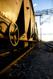 Golden train. Rusty Freight trains on sunrise with golden reflection Royalty Free Stock Images