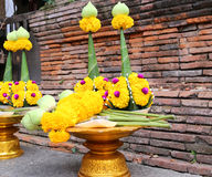 Golden tray with pedestal and flowers for making a merit Royalty Free Stock Images