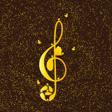 Golden treble clef with birds Stock Images