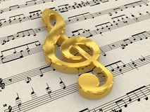 Golden treble clef on score paper Royalty Free Stock Image
