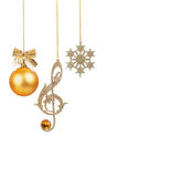 Golden treble clef, snowflake and Christmas ball Royalty Free Stock Photo