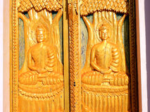 Golden tree carving. Golden tree and buddha carving door stock photo