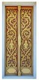 Golden tree and deva carving door Stock Photos