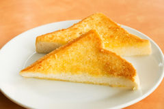 Golden triangle toast in the white dish Royalty Free Stock Images